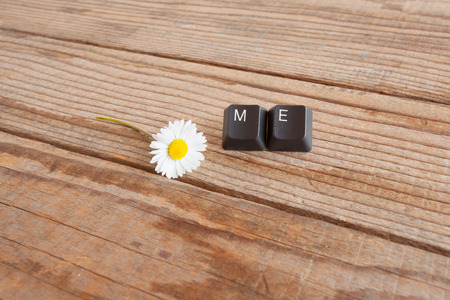 wrote: me wrote with keyboard keys on wooden background