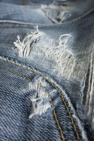 worn: Worn blue jeans as background Stock Photo