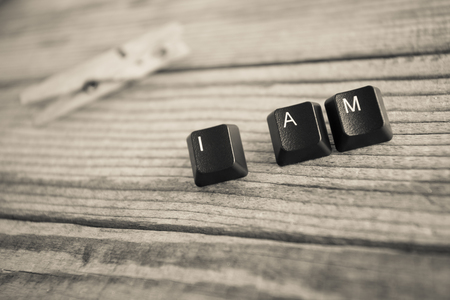 i am: I AM wrote with keyboard keys on wooden background Stock Photo