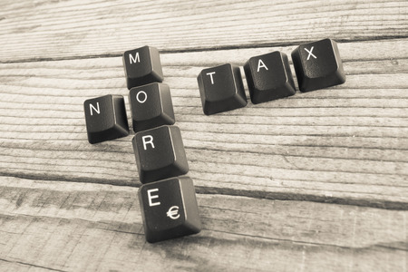 wrote: NO MORE TAX wrote with keyboard keys on wooden background Stock Photo