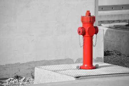 fire hydrant: Fire hydrant in long construnction site, black and white effect