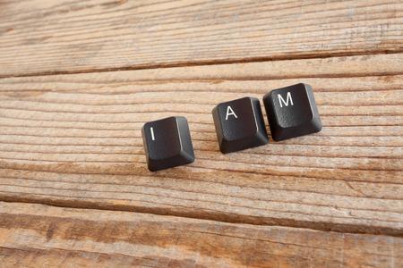 I AM wrote with keyboard keys on wooden background Standard-Bild