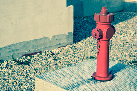 fire hydrant: fire hydrant long to construnction site, vintage denim effect Stock Photo