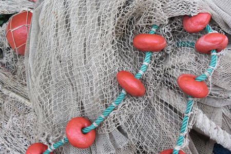 fish net: Used fishing net with floaters Stock Photo