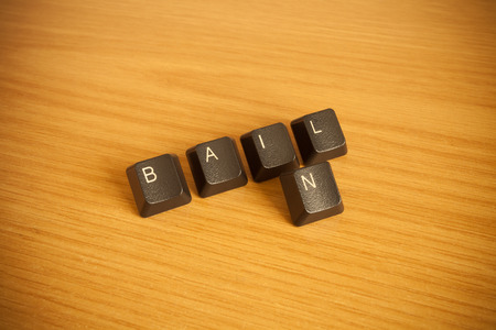 wrote: Bail-in wrote with keyboard key in wooden background