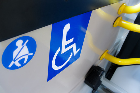 onboard: reserved seat label onboard bus for disabled people Stock Photo