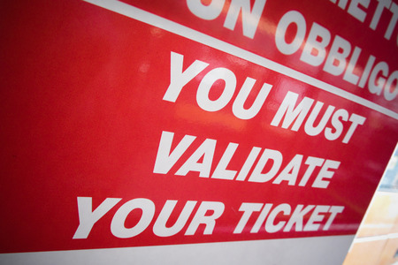 a public notice: you must validate your ticket on city bus