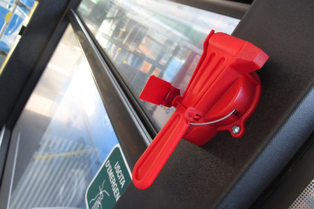 evacuation: Red evacuation hammer on public transport Stock Photo