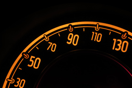 a public notice: speedometer at night inside a car Stock Photo
