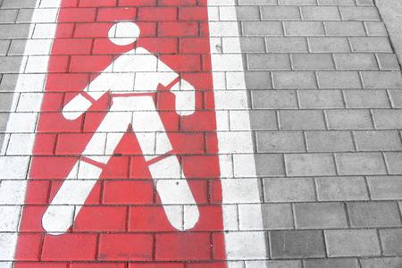 pedestrians: red pedestrians lane along a sidewalk Stock Photo