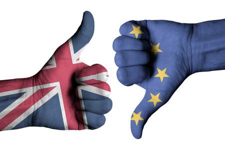 Union Jack flag and European flag on human hands