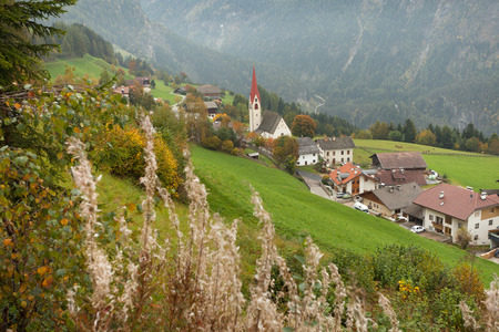 autumnal view toward the little town of Acereto in Ahrntal