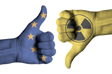 Nuclear icon on male thumb up and down  hand Stock Photo