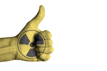 uranium: Nuclear icon on male thumb up hand