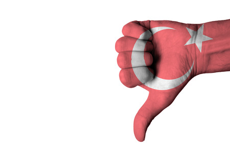 negative: Turkey flag on human male thumb down hands