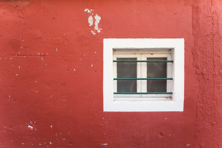 burano: small window from a red house in Burano island, Venice