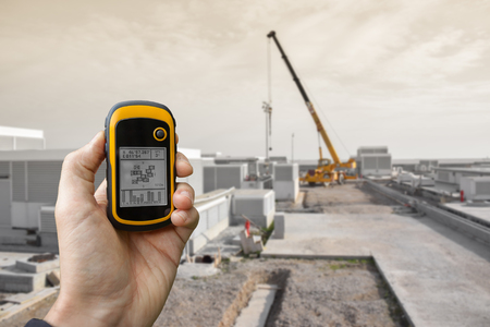 VENICE, ITALY - SEPTEMBER 22, 2014: finding the right position inside a construction site via gps ( blurred background ) Editorial