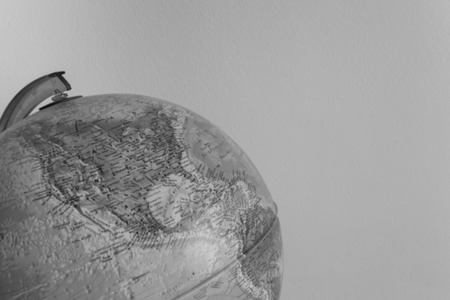 assignments: OUT OF FOCUS: Globe with physical map on it ( vintage effect )