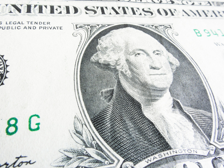 Details of a one dollar bill, George Washington in foreground