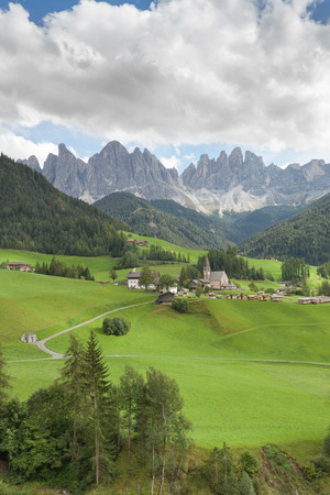 Small Italian mountain town in the Dolomites ( St. Magdalena in Val di Funes ) Stock Photo