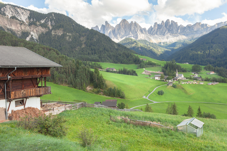 val: Small Italian mountain town in the Dolomites ( St. Magdalena in Val di Funes ) Stock Photo