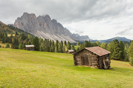 Old hayloft in a pasture in Val di Funes at the fall (Dolomites - Odle group in the background)