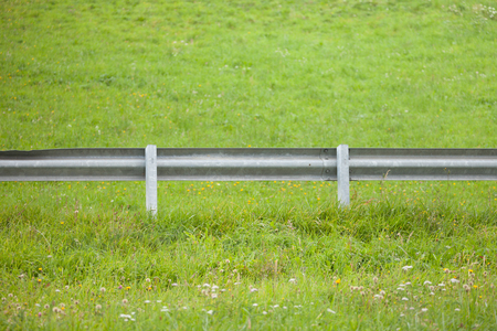 secondary road guardrail in a mountain pasture Stock Photo
