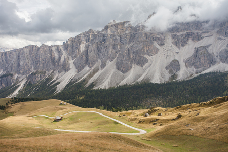 a path long an alpin pasture in the Italin Dolomites in autumn Stock Photo