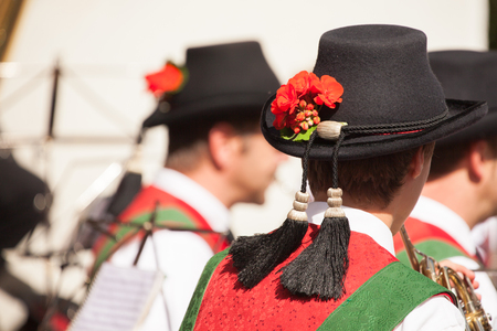 Young musician in typical costume during an autumn local celebration in Val di Funes ( South Tyrol )