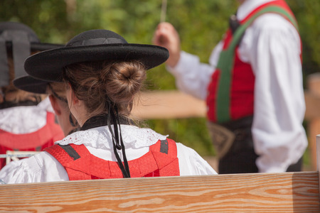 Young musician girl in typical costume during an autumn local celebration in Val di Funes ( South Tyrol ) Stock Photo