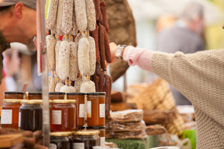 typical food market stall during an autumn local celebration in Val di Funes ( South Tyrol )
