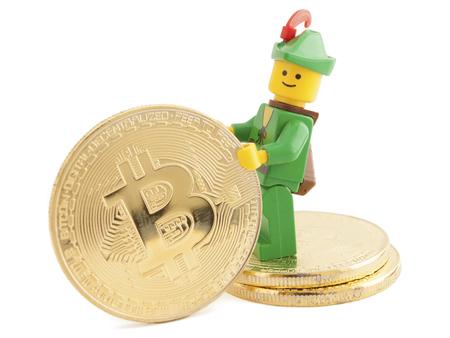 Venice, Italy - January 07, 2018: Robin Hood (as Lego figure) standing next to Bitcoin coins, January 07, 2018 in Venice, Italy