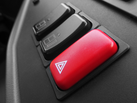 Focus over a red emergency triangle button inside a bus Banco de Imagens