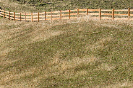 Wooden fence from a pasture in Val di Funes in Italy