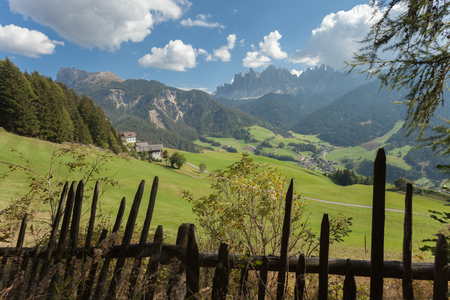 Wooden fence next to  an Italian mountain pasture in St. Magdalena in Val di Funes