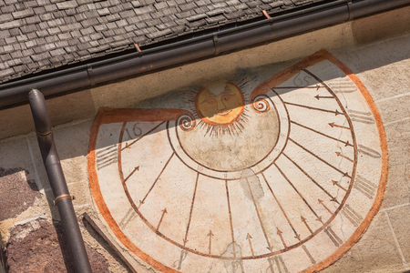 VAL DI FUNES, ITALY - SEPTEMBER 29, 2016:  A detail of the old sundial painted on 1465 over the external wall of the little chapel of St. Magdalena in Val di Funes