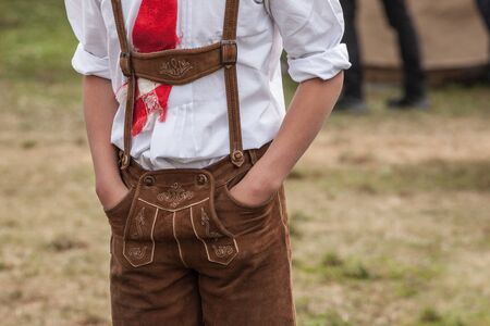 Every year in October next to the small Italian little church of St. Magdalena in Val di Funes the local celebration Speckfest is arranged: traditional local clothes, habits and food. Фото со стока