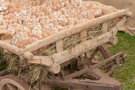 Traditional Rye flour bread cooked on site during the Speckfest celebration in Val di Funes, Dolomites.