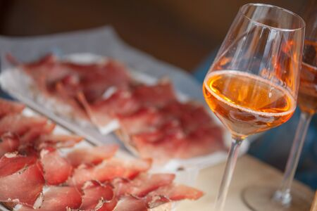 Traditional smoked speck sliced on site during the Speckfest celebration in Val di Funes, Dolomites. Фото со стока