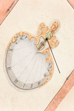 A detail of the old sundial painted on  the external wall of the little chapel of St. Johan in Val di Funes Banco de Imagens - 134848038