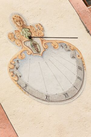 A detail of the old sundial painted on  the external wall of the little chapel of St. Johan in Val di Funes Banco de Imagens - 134848669