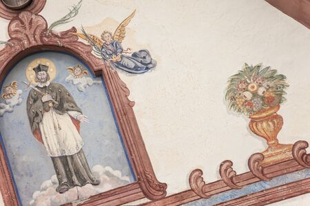 A detail of an old fresco painted on the external wall of the little chapel of St. Johan in Val di Funes Banco de Imagens - 134848756
