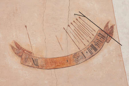SIUSI, ITALY - JULY 27, 2017: Colorful sundial painted outside the wall of the Maria Ausiliatrice little church. The history of this church dates back to the XVII century