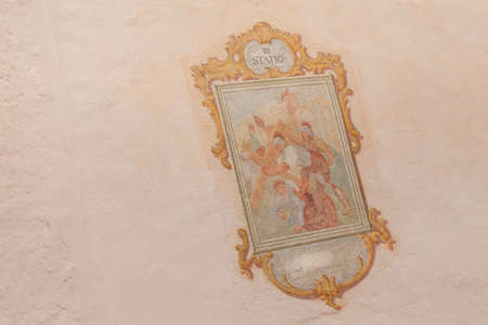 SIUSI, ITALY - JULY 27, 2017: Fresco painted outside the wall of the Maria Ausiliatrice little church representing a moment on the Way of the cross (Station I). The history of this church dates back to the XVII century Editorial