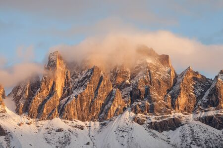 view on the Odle mount in Val di Funes, Dolomites at sunset after an autumnal storm