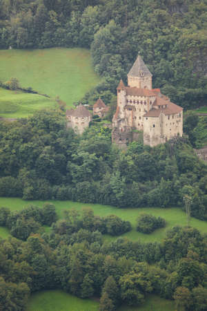 VAL ISARCO, ITALY - SEPTEMBER 14, 2017: Castel Trostburg among the woods is the main castle of the valley, located on the next to the town of Ponte Gardena it's now a local museum Editorial