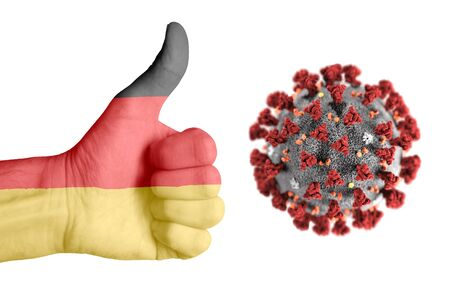 German flag on human hand  during covid