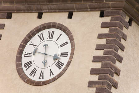 VAL DI FUNES, ITALY - SEPTEMBER 23, 2017: A detail of the clock painted on the bell tower of the St. Peter church, recently restored it shows all its original vivid colors