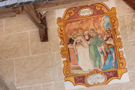 VAL DI FUNES, ITALY - SEPTEMBER 18, 2017: Fresco from the St. Magdalena little church in Val di Funes representing a moment on the Way of the cross: 14th Station