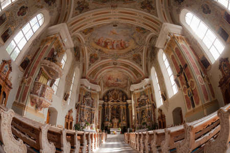 VAL DI FUNES, ITALY - SEPTEMBER 23, 2017: Internal wide view of the St. Peter church in Val di Funes, the main church in the valley